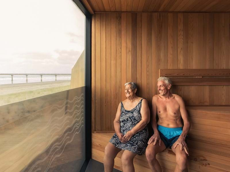 Man and woman relaxing in sauna