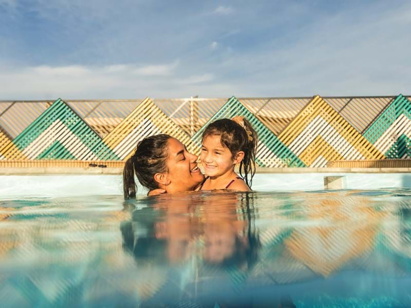 Woman and girl in a hot pool