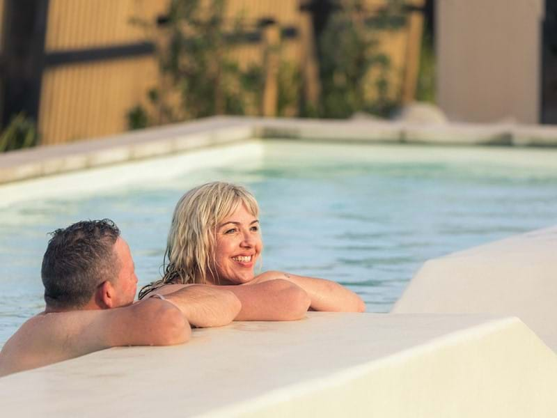 Man and woman in a hot pool